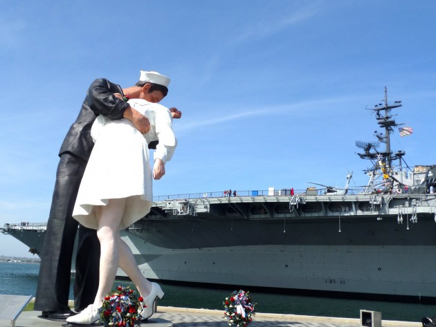 The Unconditional Surrender statue with the USS Midway Aircraft Carrier Museum in the background.